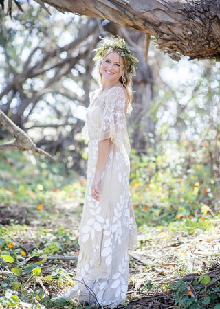 bohemian-bride-with-unique-dress-leaf-detailing-floral-garland-crown-in-forest