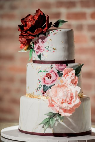 three-tier-wedding-cake-with-light-gray-fondant-hand-painted-pink-flowers-gold-leaf-sugar-dahlias