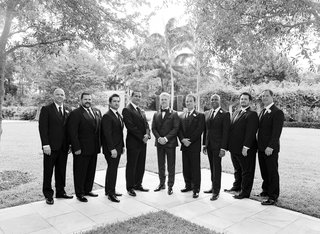 black-and-white-photo-of-groom-in-custom-tuxedo-with-groomsmen-in-suits-palm-beach-florida