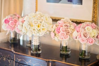 bride-and-bridesmaids-bouquets-with-pink-white-and-yellow-roses
