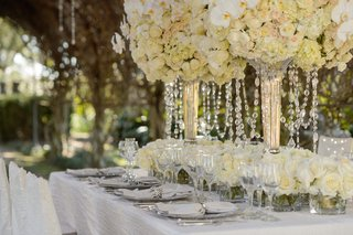 tall-white-and-ivory-flower-decorations-with-crystals-hanging