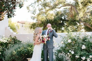 bride-laughing-as-groom-uses-handkerchief-after-an-emotional-first-look