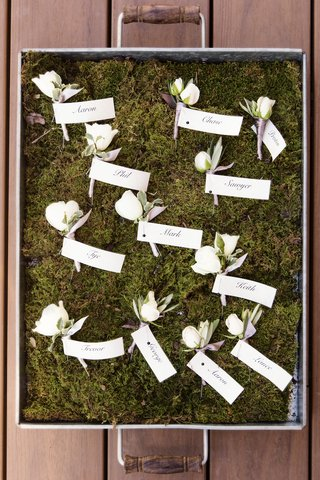 ivory-rose-buds-wrapped-in-violet-ribbon-with-name-flags