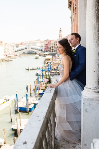 bride-in-hayley-paige-wedding-dress-groom-in-navy-blue-tuxedo-suit-venice-italy-elopement-views