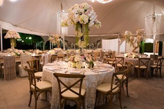 white-lace-tablecloth-with-rustic-chairs-and-tall-centerpieces