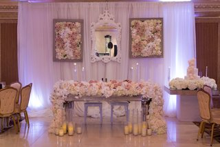 sweetheart-table-at-ballroom-armenian-reception-with-lush-flower-overflowing-runner-flower-panel