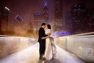 bride-in-a-carolina-herrera-gown-with-bustle-train-with-groom-in-tuxedo-in-chicago