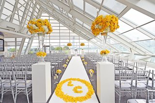 wedding-ceremony-at-the-adler-planetarium-with-bride-and-grooms-monogram-in-yellow-rose-petals