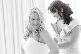 black-and-white-photo-of-bride-in-strapless-maggie-sottero-gown-with-mother-in-sleeveless-dress