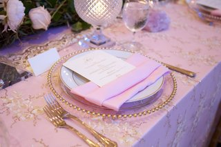 pink-wedding-reception-decor-gold-charger-plate-forks-and-linen-accents-candle-votives