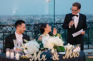 father-of-the-bride-gives-toast-standing-by-sweetheart-table