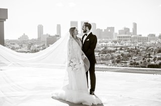 black-and-white-photo-of-bride-and-groom-on-rooftop-of-four-seasons-hotel-los-angeles-city-view-la