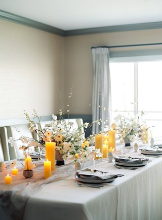 bridal-shower-soft-blue-and-grey-color-scheme-yellow-pillar-candles