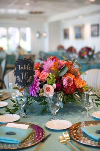 bright-colored-flowers-centerpiece-beach-wedding