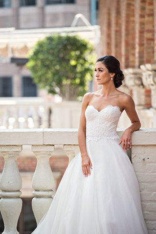 bride-in-reem-acra-ball-gown-wedding-dress-with-lace-bodice-and-sweetheart-neckline-tulle-skirt