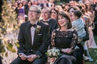 wedding-ceremony-mother-of-bride-in-black-lace-illusion-oscar-de-la-renta-dress-father-in-bow-tie