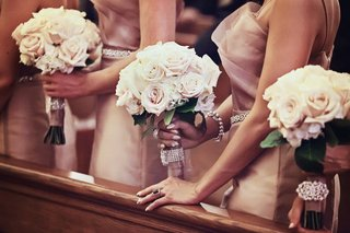 bridesmaids-at-ceremony-holding-nosegays