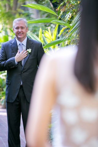 wedding-ideas-vow-renewal-first-look-groom-seeing-bride-for-first-time-married