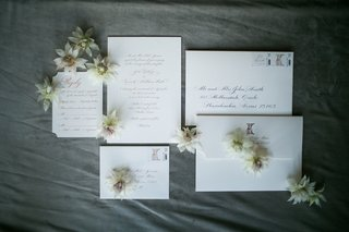 wedding-invitations-with-envelopes-and-flowers-ivory-white
