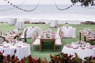 wedding-reception-hawaii-plantation-lawn-long-wood-table-round-purple-table-patio-lights-overhead