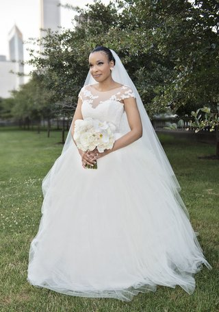 bride-in-legends-romona-keveza-a-line-wedding-dress-and-illusion-neckline-and-cap-sleeves
