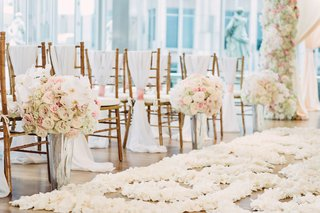 mercury-glass-vases-with-pink-rose-white-hydrangea-white-orchid-flower-arrangement-at-ceremony