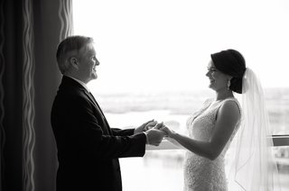 black-and-white-photo-of-father-seeing-daughter-in-dress