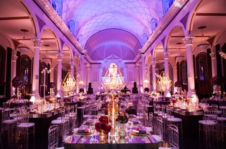 vibiana-wedding-reception-room-shot-with-chandeliers-in-gold-frames-mirror-tables-purple-lighting