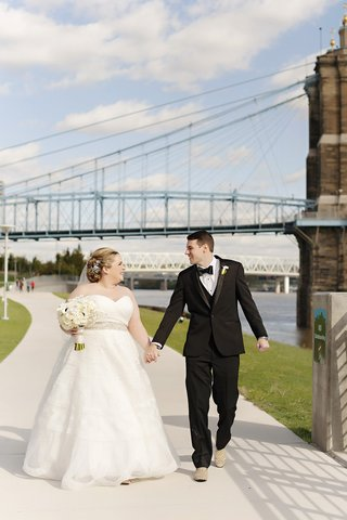 bride-in-strapless-sweetheart-watters-wedding-dress-groom-in-michael-kors-tux-bridge
