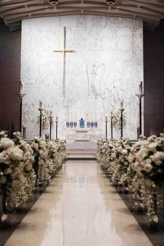 wedding-ceremony-at-pretty-church-white-altar-flowers-on-church-pews-decorated-no-runner-aisle