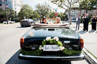 bride-and-groom-in-convertible-rolls-royce-corniche-car-from-ceremony-to-reception