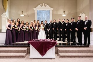 baptist-church-wedding-ceremony-alter-with-bridesmaids-in-purple-and-groomsmen-in-suits-bow-ties