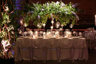 wedding reception table long rectangle ghost chairs orbs candlelight greenery blue purple delphinium