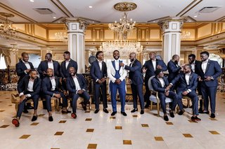 wedding-photo-of-groom-and-groomsmen-in-tuxedos-and-bow-ties-at-the-legacy-castle-in-new-jersey