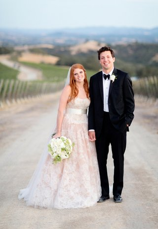 redhead-bride-in-blush-gown-and-tuxedo-groom