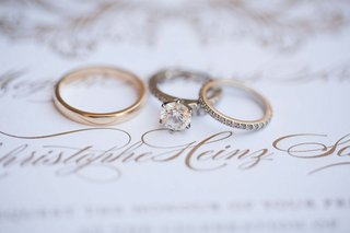 a-six-prong-engagement-ring-and-a-brides-diamond-studded-band-a-grooms-gold-band-wedding-invitation