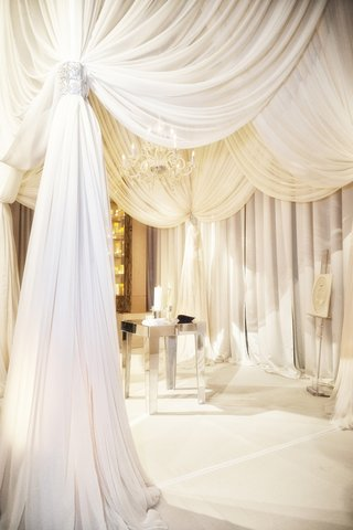 white-billowing-fabric-and-mirrored-altar-tabletop