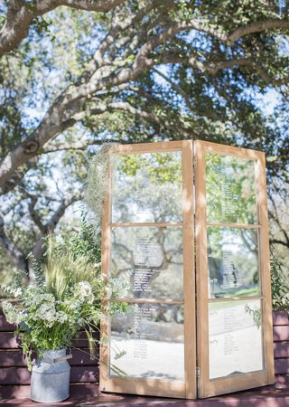 mirror-to-write-a-message-to-the-couple-rustic-white-and-green-wildflowers-on-display