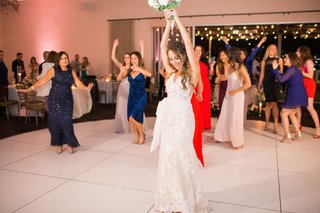 bride-in-lace-stella-york-gown-about-to-throw-bouquet-to-female-guests