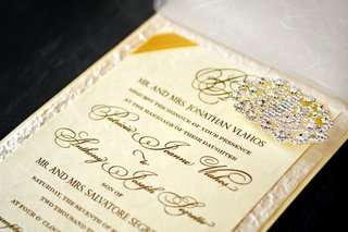gold-and-ivory-invite-with-crystal-brooch