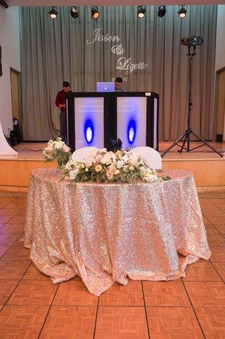 sweetheart-table-pink-sequin-table-linen-low-florals-on-dance-floor-california-wedding