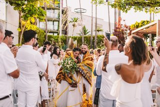 bride-and-groom-wrapped-in-chumash-indian-ceremony-blanket