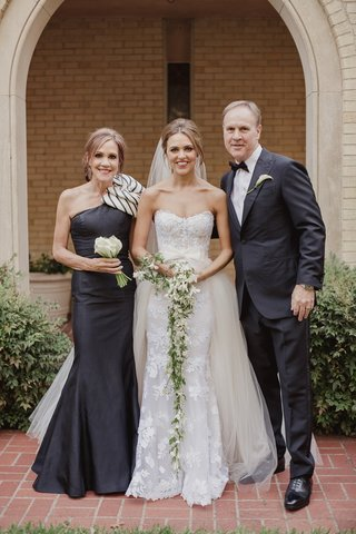 bride-in-mira-zwillinger-wedding-dress-with-mark-ingraham-overskirt-mother-in-chic-dress-with-bow
