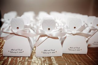 favor-boxes-in-shape-of-bridal-gown-with-ribbon-and-pearls
