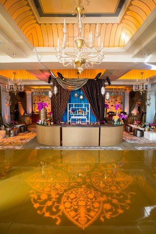 moroccan-style-engagement-party-with-henna-pattern-projection-on-gold-dance-floor