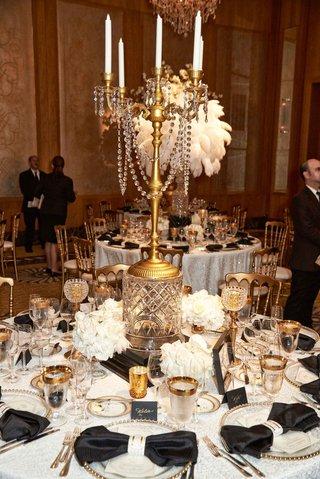 wedding-reception-vintage-deco-inspired-crystals-gold-candelabra-centerpiece-tall-arrangement