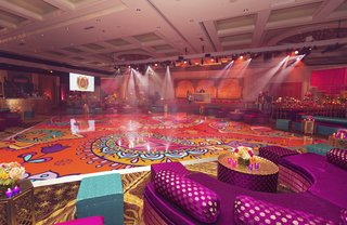 indian-sangeet-with-bright-fuchsia-turquoise-orange-patterned-dance-floor