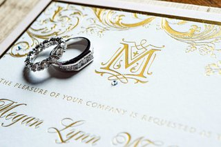 megan-wollover-and-tracy-morgan-wedding-invitation-with-gold-letterpress-and-monogram-with-rings