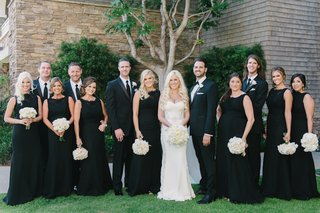 bride-in-a-galia-lahav-gown-with-lace-panels-groomsmen-bridesmaids-in-sleeveless-black-dresses