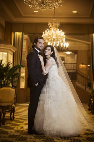 bride-in-lace-vera-wang-ball-gown-cathedral-veil-groom-in-tuxedo